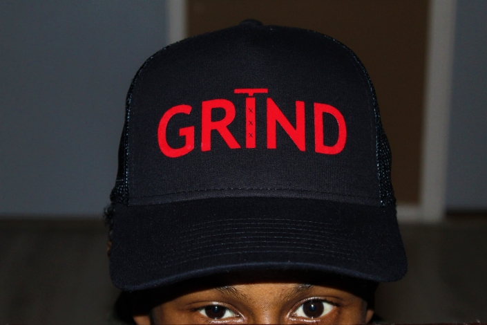GRIND - Black Trucker Cap With Red Print